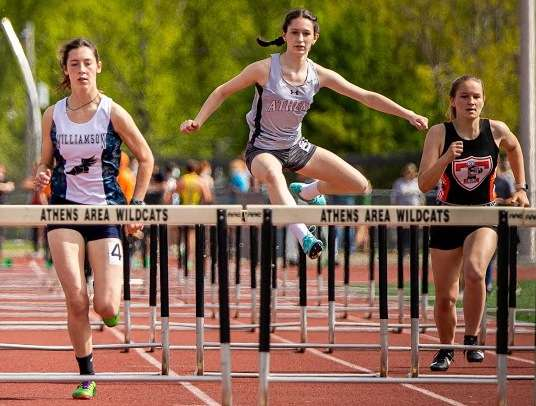 TRIPLE-WINNER BRONSON PACES ATHENS' EFFORTS AT TL COACHES' INVITE